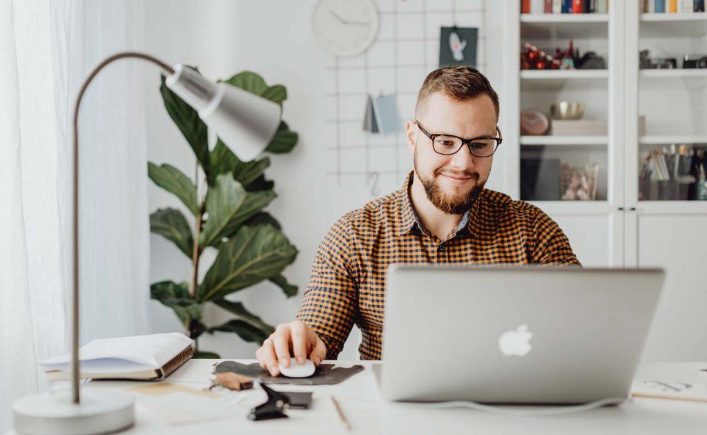 Vacation Rental Software - Man Using Computer