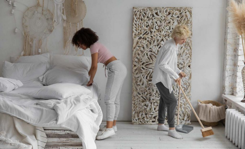 Two women cleaning an Airbnb